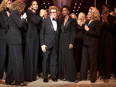Yves Saint Laurent onstage with models