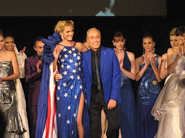 Designer Renato Balestra stands with a model as his debut showing in America comes to an end Thursday, April 16, 2011.