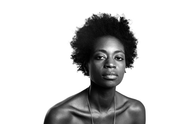 Me (Penny) posing for the AFRO series. Photo by @thebenchmarc